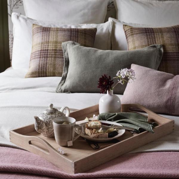 breakfast tray on cosy bed